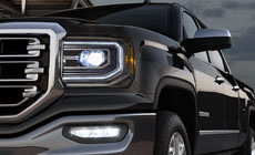 Picture showing advanced lighting featured on the 2017 GMC Sierra 1500 light-duty truck.