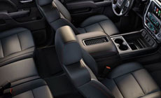 Photo of the comfortable and spacious interior of the 2017 GMC Sierra 1500 light-duty pickup truck.