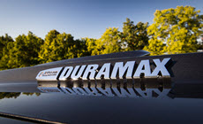 Image of the Duramax logo, featuring enhanced driveline and cooling components.